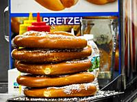Pretzel. A type of baked bread product made from dough most commonly shaped into a twisted knot. Pretzels originated in Europe, possibly among monaste...