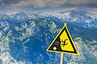 Triglav mountain range and danger signal. Triglav National Park. Upper Carniola region. Slovenia, Europe.