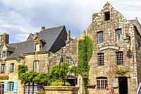 LOCRONAN, BRITTANY, FRANCE: View of a street in Locronan, one of the most beautiful villages in French Brittany, where unknown tourists stroll.