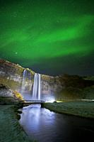 Seljalandsfoss Waterfall and Aurora Borealis, Iceland.