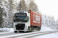 Salo, Finland - December 23, 2018: White Volvo FH 500 semi truck pulls Spedition Bode trailer on snowy road on a cold day of winter in Finland.