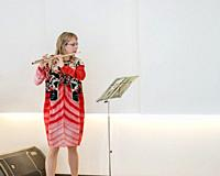Playing the Flute, Summer Festival, Cultural Day, Reykjavik, Iceland.