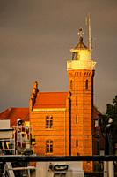 Old lighthouse in golden evening lighting.