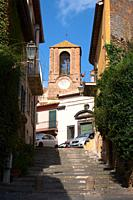 ancient road and bell tower of the church of the assunta, anguillara sabazia, lazio, italy.