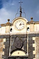 antique clock with bells above the entrance door of the city, anguillara sabazia, lazio, italy.