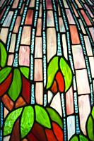 Close-up details of a green, red and pink stained glass lamp shade, Laval, Quebec, Canada.