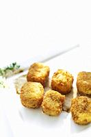 fried mashed potato square croquettes simple vegetarian side dish on white plate.