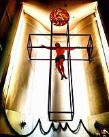 A sculpture of Jesus Christ crucified inside a cubic cross decorates an altar in a church in Mexico City, Mexico