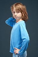 Portrait of a Boy with Long Blond Hair in Blue Top.