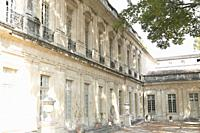 Gracious courtyard facacde of Musee Calvet, with repeating windows, pilasters, decorative carvings and elegant metal work balconies, recalls a waterco...