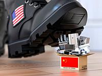 USA China technology war and market conflict. Economic trade war concept. Cardbox with appliance made in China and american military boot above it. 3d...