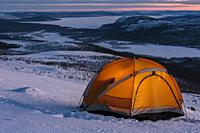 Tent on mountain with a wonderful view in winter in Swedish lapland, Sweden.