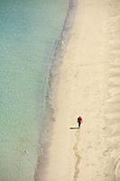 Man walking on the beach at Playa Tecolote near La Paz, Baja California Sur, Mexico.