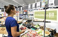 Woman buying fruit in Lidl supermarket on Gran Canaria, Canary Islands, Spain. Model released.