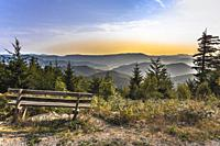 panorama with the mountain range of Northern Black Forest, Germany, view point with bench at the Westweg hiking trail.