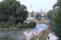 crowds of people taking a bath in the river Isar on a hot summer day. Munich, Bavaria, Germany