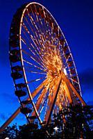 The Navy Pier Ferris wheel glows at dusk.