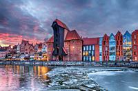 Gdansk Zuraw, a famous sight on the bank of Motlawa river, winter sunset.