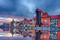 Gdansk beautiful sunset, view on Zuraw port crane and medieval facades, Poland.