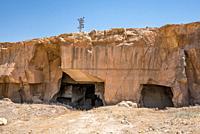 Exterior view of Bazda Caves for mining of stone in Harran,Sanliurfa,Turkey.