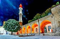 Night view Sehidiye Mosque and Madrassa though arch,a popular landmark in Mardin,Turkey.