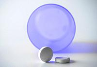 Tablets with isolated bottle on white background, conceptual image.