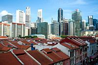 Singapore, Republic of Singapore, Asia - An elevated view of the roofscape in Chinatown and the city skyline of the Central Business District in the b...