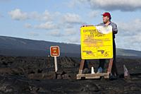 End of trail. Black lava mountains near the coast and highway Chain of Crater Road. Hawai´i Volcanoes National Park. Big Island. Hawaii. Lava fields a...