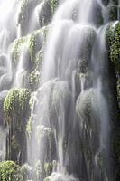 Detail of beautiful waterfall full of green moss.