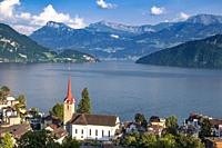 Parish Church St. Maria and the village of Weggis overlooking Lake Lucerne, Switzerland.