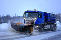 Salo, Finland - January 26, 2019: Blue Scania truck of equipped with snowplow clears a snowy road in suburban area on a winter afternoon.