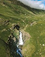 Las Negras waterfall, Izas valley in the Pyrenees, snow in gone and the valley turns green.