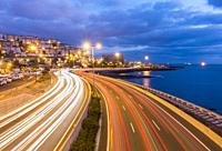 Las Palmas, Gran Canaria, Canary Islands, Spain. Morning rush hour traffic entering Las Palmas on Avenida Maritima.
