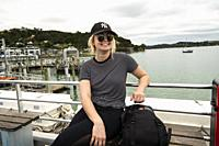 Young woman on the passenger ferry boat to Russell, . New Zealand.