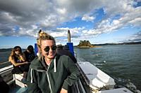 A young woman, smiling, on the ferry to Russell, New Zealand.