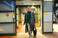 Stockholm, Sweden A young man arrives and exits customs at Arlanda airport, Terminal 2.