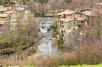Set of waterfalls of the river Rupit as it passes through the medieval town of Rupit, Catalonia, Spain.