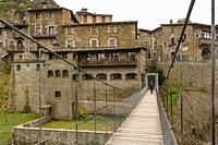 RUPIT, CATALONIA, SPAIN: View of the historic center of Rupit with its hanging footbridge.