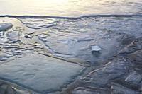 Ice covering a harbor bay in winter