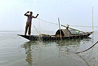 Fisherman cleaning plastics and other materials from their fishing net after fish in the Brahmaputra river in Guwahati, Assam on Tuesday, 19 February,...