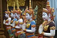 Row of statues at Sen Monorom pagoda, Mondolkiri Province, Cambodia, South east Asia.