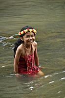 Young girl wearing flower garland on head in Bou Sra waterfall near Sen Monorom, Mondolkiri province, Cambodia, South east Asia.
