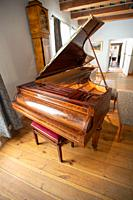 A wooden piano used by Polish composer and pianist Fryderyk Chopin sits open inside the Museum of Fryderyk Chopin. Zelazowa Wola, Masovian Voivodeship...