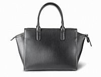 Ladies black leather bag back view isolated on white background.