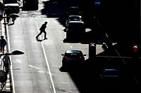 Man crossing the street in the wrong way. Oporto, Portugal.