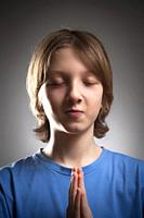 Portrait of a Boy with Closed Eyes Praying.