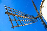 Windmill, view from below an arm. Campo de Criptana, Ciudad Real province, Castilla La Mancha, Spain.