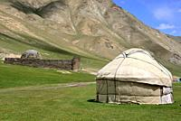 Yurts and Caravanserai in Tash Rabat valley, Naryn province, Kyrgyzstan.