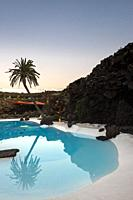 Pool designed and built inside a volcanic cave. Jameos del Agua, Lanzarote. Spain.