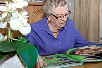old woman reading book.